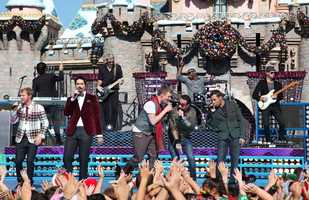 Backstreet Boys perform in front of Sleeping Beauty Castle.