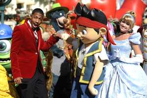 "Cannon gives a fist-bump to Disney Junior character ""Jake"" while taping the ""Disney Parks Christmas Day Parade."""