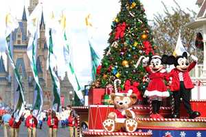 "Mickey and Minnie Mouse wave to the crowd Dec. 1, 2012 while taping the ""Disney Parks Christmas Day Parade."""
