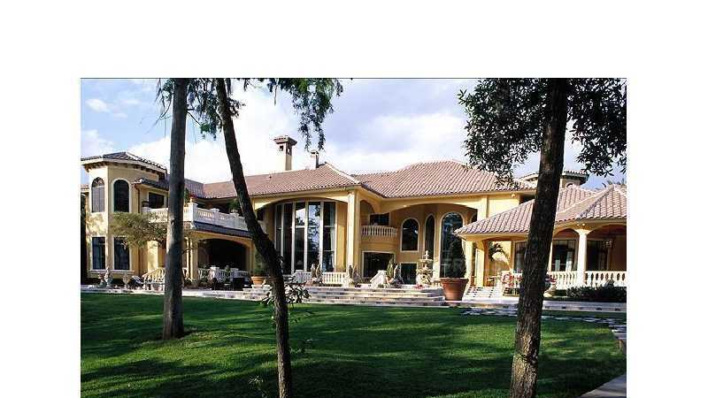 Listed at $4.8 million on realtor.com, this mansion sprawls over 12,232 square feet. It has 6 bedrooms, 10 bathrooms, and much more. Start the tour.