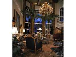 This formal area can be illuminated by its beautiful chandelier at  night.