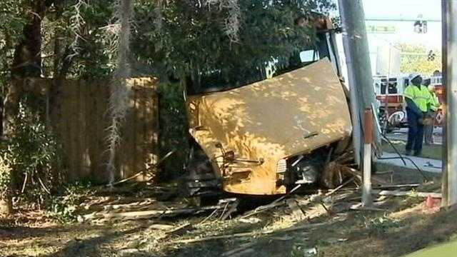 A school bus hit a power pole Tuesday after running a red light, according to the Florida Highway Patrol.