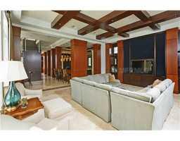 The family room features a custom media unit.