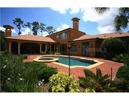 The home itself is 6,199 square feet and includes an exquisite outdoor pool and spa, steps from the neighborhood's lake.
