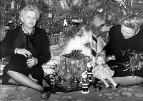 1942: Margaret Hodges and a guest sit near the Christmas tree in Tallahassee.
