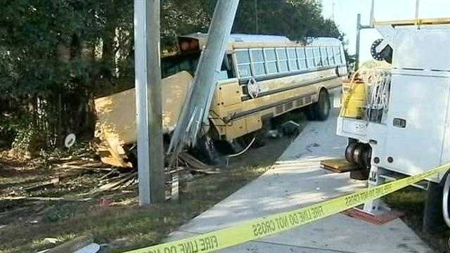 A school bus driver in Seminole County who ran a red light and plowed into a power pole earlier this month is off the job.