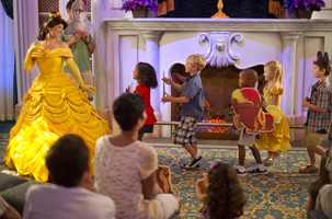 """In an interactive, new kind of character experience, New Fantasyland guests at """"Enchanted Tales with Belle"""" step right into the story of Disney's Beauty and the Beast."""