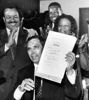 "Gov. Robert ""Bob"" Martinez signing Dr. Martin Luther King Jr. holiday measure into law in Tallahassee in 1988."