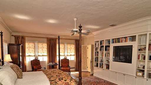 This is one of 3 bedrooms in the home. In total, the home has 3 bedrooms and 5 bathrooms in the main house.