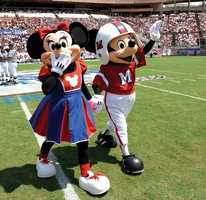 Minnie is also a big football fan.  She cheers on Mickey from the sidelines in her cheerleading outfit.