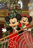 Aboard the Disney Cruise Lines, Mickey and Minnie match in their plaid holiday outfits.
