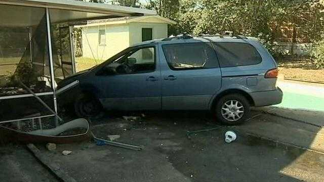 Rescuers pull passengers from a vehicle that crashed into an Orange County home.