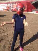 Aixa tries on the Spiderman helmet.