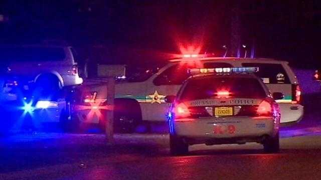 Who called 911 to report a deputy was down? Investigators want to know.