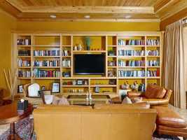 The custom and simple bookshelf is the focus of this room.
