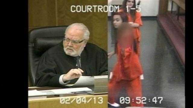 Raw video: Suspect flips off judge