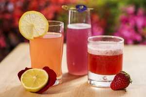(Left to right) Chilled Rose Blush Lemonade (The Cottage marketplace near UK pavilion), Frozen Desert Violet Lemonade (Pineapple Promenade marketplace) and Strawberry Slush (Florida Fresh marketplace).