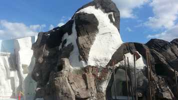 Penguin Mountain greets entrants to the park's new ride.
