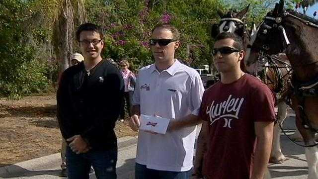 A NASCAR driver gives two Marines from Ormond Beach tickets to the Daytona 500.