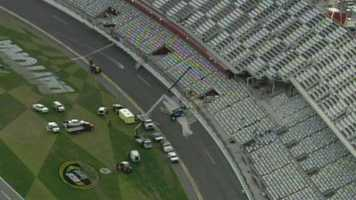 The crash began as the field closed in on the finish line and sent rookie Kyle Larson's car sailing into the fence that separates the track from the seats.