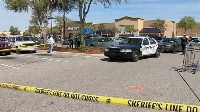 Gunfire erupts in the parking lot of an Orange City Walmart store on Wednesday.