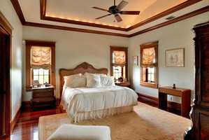Master bedroom features vaulted, molded ceilings.