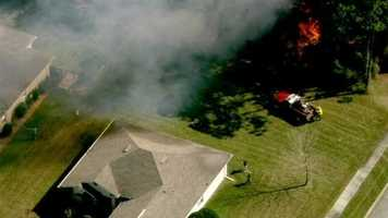 A fast-moving brush fire in Port Orange threatened homes Tuesday afternoon.