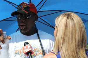 Dennis Rodman stays in the shade for his interview.