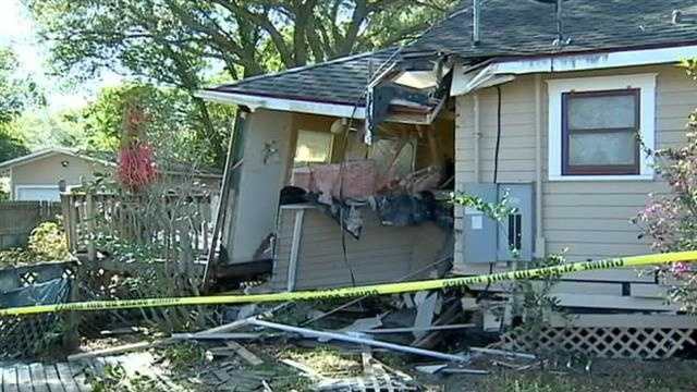 Garbage truck damages home