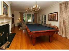 Unconventional game room features a pool table but can be redecorated into any type of family space.