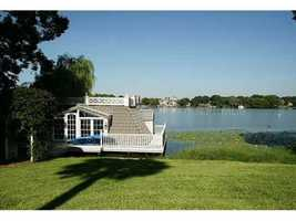The home also has private dock entrance to the lake. For more information on this home, visit Realtor.com.