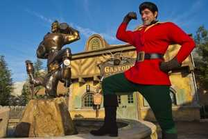 """Erin said Gaston is thinking, """"Why yes, I really AM this good looking as a bronze statue and in person! Now where is my Belle?"""""""