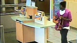 A bandit wearing women's clothes and fuzzy pink slippers made off with cash from a Sebastian bank Tuesday, police said.
