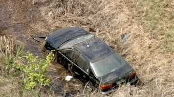 Five people were taken to a hospital after the car they were riding in overturned into a ditch.