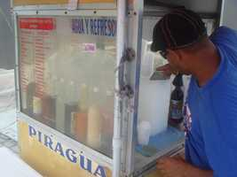 "When she visits Old San Juan, Aixa always gets a ""Piragua"" -- shaved ice with flavored syrup. She loves coconut or cream!"
