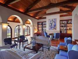 The formal living room has wood floors, afireplace and gorgeous lake views.