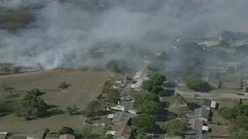 A brush fire threatened homes in Ocoee on Monday afternoon.