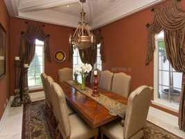 The formal dining room overlooks the pool and seats eight.