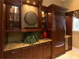 This is a close up of the the custom fridge, cabinets and wet bar.