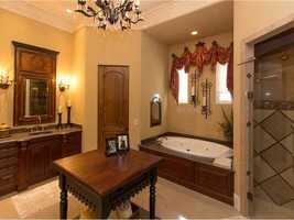 The master bathroom features a Fireside Roman tub.