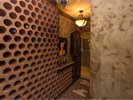 The wine cellar has room for hundreds of bottles.