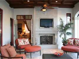 The master suite opens into the veranda, which features its own fireplace steps from the pool.