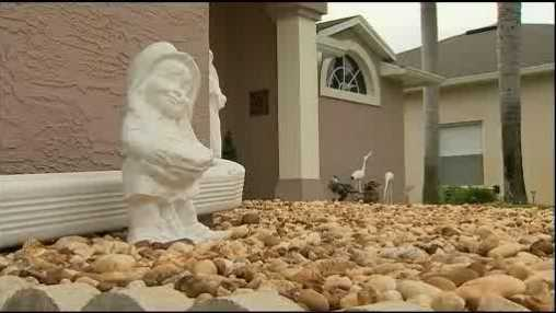 A Port Orange woman says it's a sin that her homeowner's association is ordering her to remove a statue of an angel from her front yard.