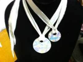 A company called Love Ashes makes vintage looking jewelry from the ashes of someone who has died.  Each piece is made of dichroic glass and includes ashes which are placed in the artwork and then kilned.