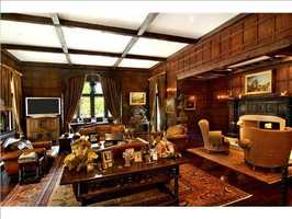 The study showcases exemplary mill work and one of the mansion's 14 fireplaces.