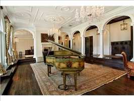 The master suite is complete with a one-of-a-kind antique piano.