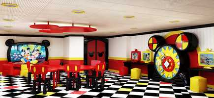 Mickey Mouse Club is a new youth area in Disney's Oceaneer Club on the Disney Magic where kids can create crafts and play games on custom, ear-shaped tables, in a room splashed with Mickey's signature colors of red, yellow and black.