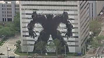 The character has created a buzz after it was placed on the Fairwinds building, which is visible from Interstate 4. Crushed cars placed next to the building are also part of the display.