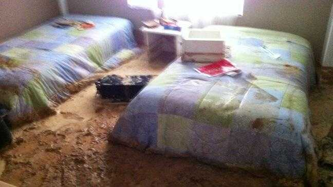 Pictures from inside the home showed mud in several rooms of the home, including a bathroom, dining room and bedroom.