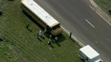 A motorcyclist was taken to the hospital after a crash with a school bus in Groveland. All of the students on the bus were OK.
